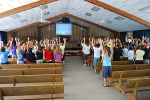 """...with trembling hands lifted high..."" the campers and staff of Teen Two 2009 singing and doing hand-motions to ""Be Glorified"""